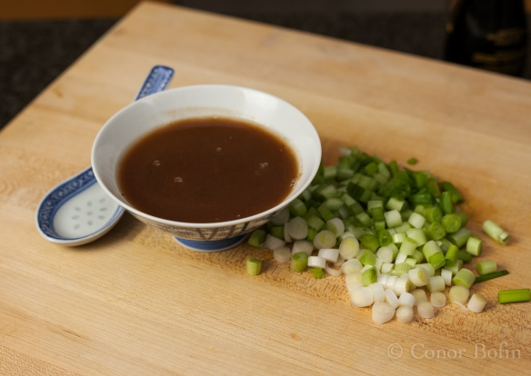 The spring onions chopped and the tamarind  sauce made.